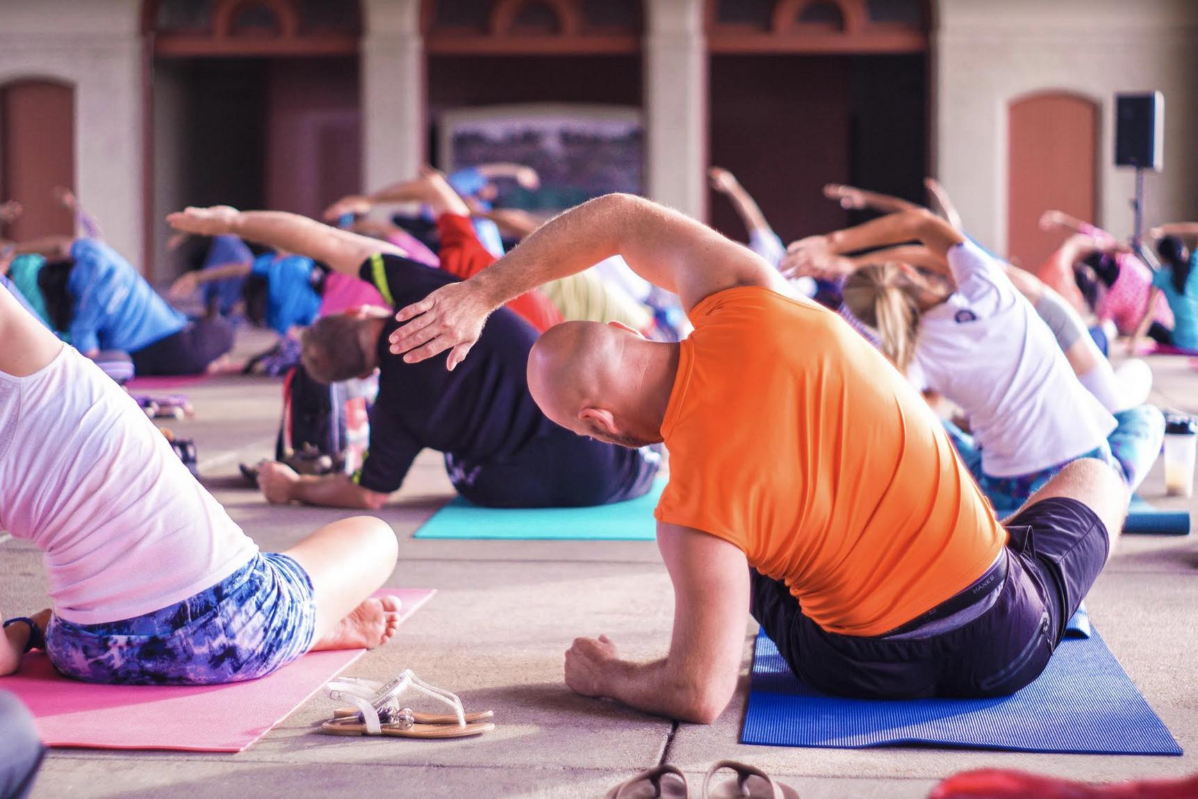 Image of a group of people doing a seated side-body stretch