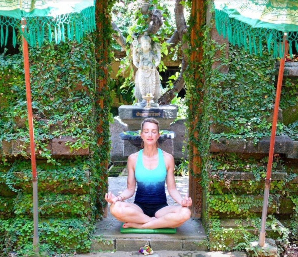 photo of woman meditating in a garden